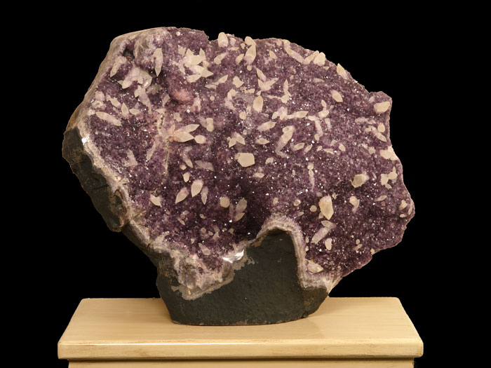 Large Brazilian amethyst geode with calcite crystals